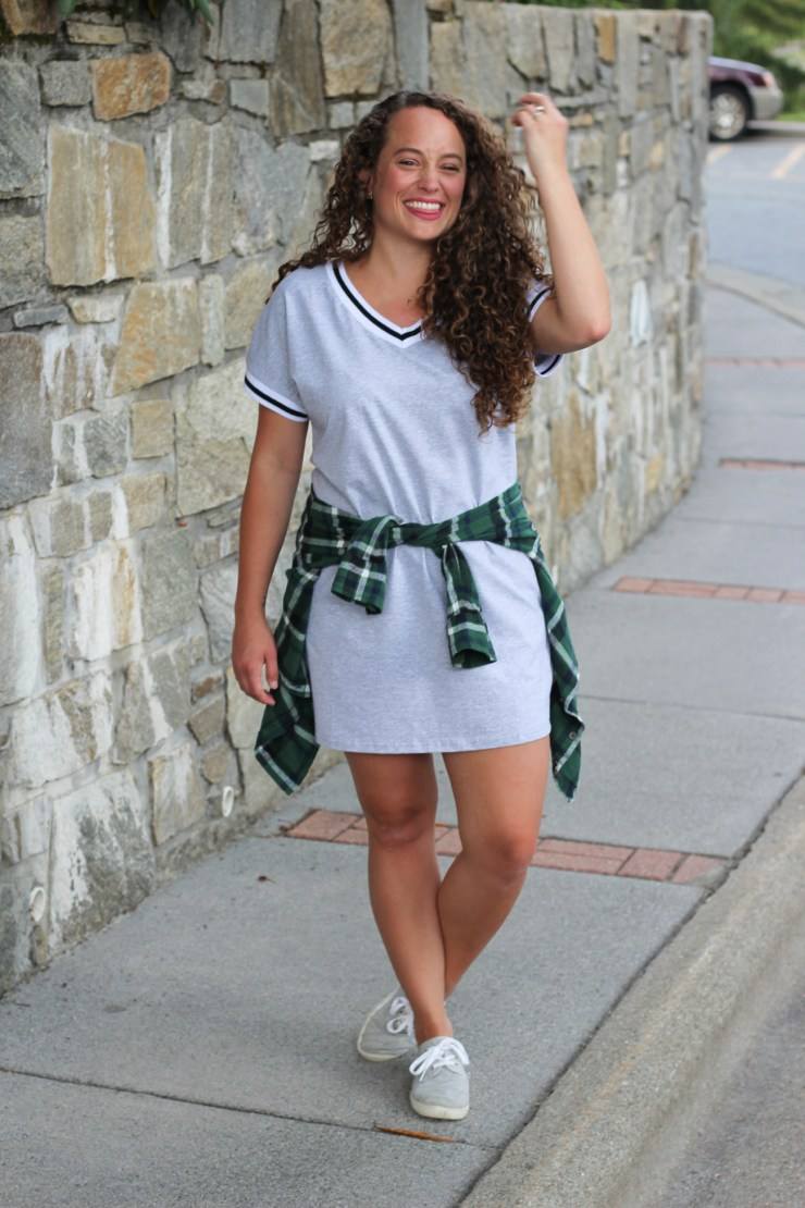 Athleisure dress paired with a tied flannel and sneakers