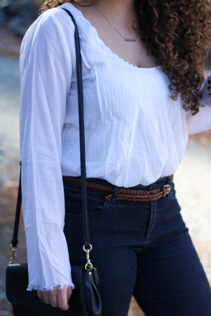 Natural Life White ruffle blouse tucked in high waisted jeans