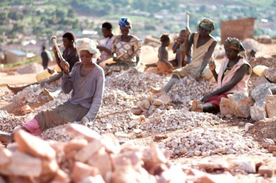 Ugandan women working in the Acholi Quarters rock quarry.