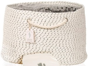 Two-tone cotton rope basket with handles and a blanket overflowing the top