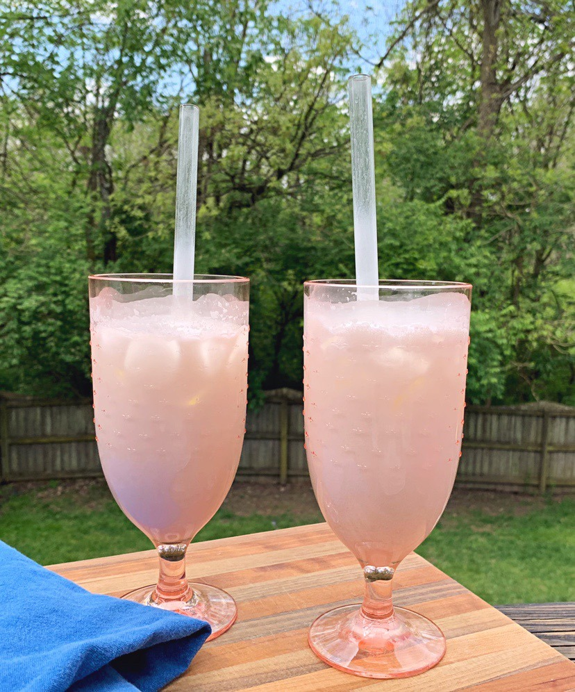 Italian Cream Sodas in tall, pink glasses.