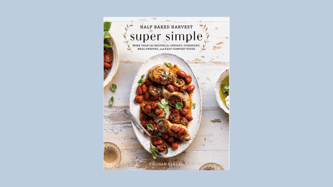 A photo of Half Baked Harvest cookbook with roasted tomatoes on the cover.