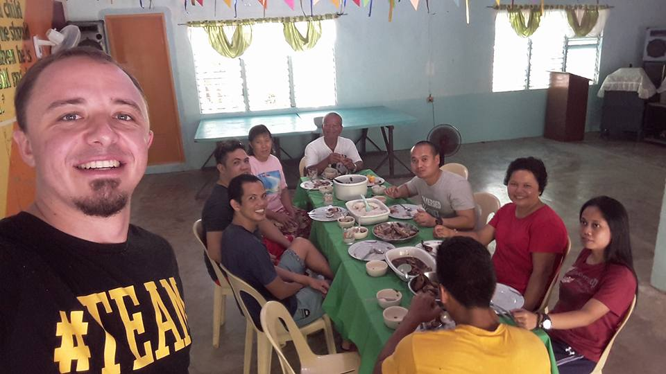 a group sitting around a table in Leyte