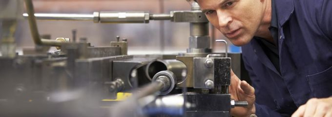 Employment in Manufacturing Sector in Birmingham, Alabama - skilled worker carefully watches machinery