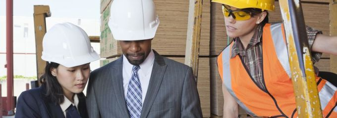 Manufacturing Careers in Birmingham, Alabama - foreman reviews manufacturing specs with workers