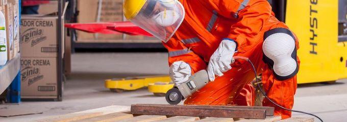 Manufacturing Job Skills in Birmingham, Alabama - worker wearing protective gear operating portable circular saw
