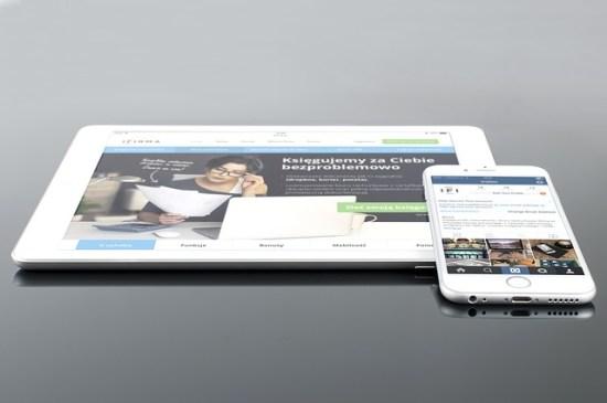 iPad and iPhone displaying company's design.