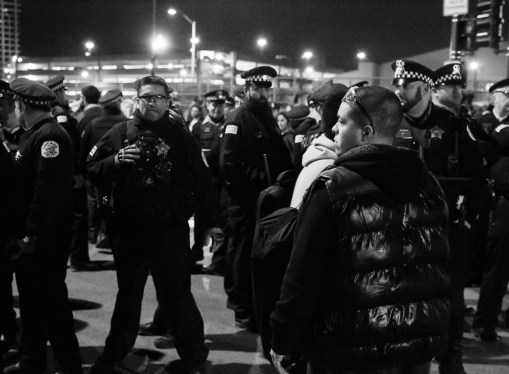 A protester and Chicago Police officer face off.