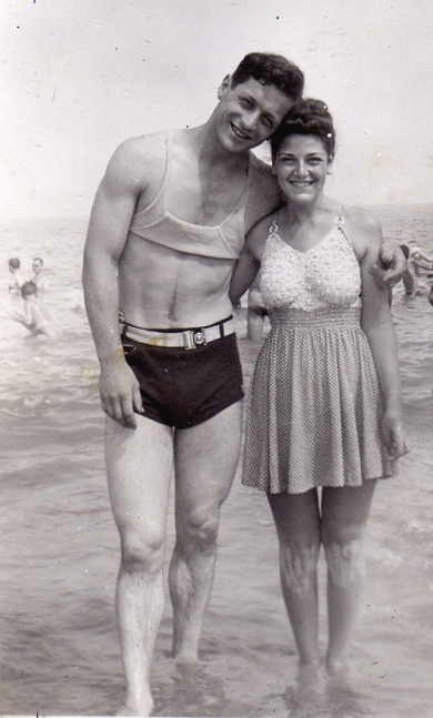 "Abraham ""Bob"" Tubin impresses his future wife Beatrice Steinberg with his washboard abs in 1940. Before beginning his career at the Boston Herald Traveler, Tubin ran the ""Sloppy Joe's"" hamburger stand on Revere Beach."