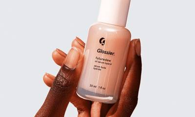 Glossier's Futuredew serum-oil hybrid gives my skin a glassy, dewy effect all day — and it's pretty affordable at $24