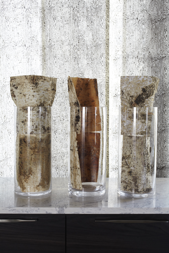 Repetition of birch bark on custom shade design and in glass cylinders.
