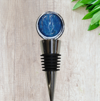 Stainless Steel Wine Stopper with colorful blue and green custom glass toppers, created by DarteGlass, a woman owned brand.