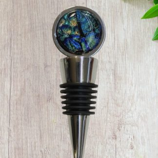 Stainless Steel Wine Stopper with colorful blue, gold and green custom glass toppers, created by DarteGlass, a woman owned brand.