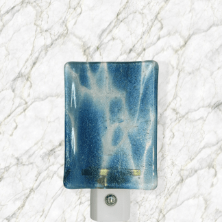 Autosensing LED night light with fused glass. Handcrafted by a woman owned brand.