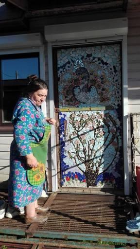 Sveta showing me the door mosaic she made