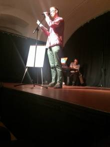 Flo performing at the poetry slam