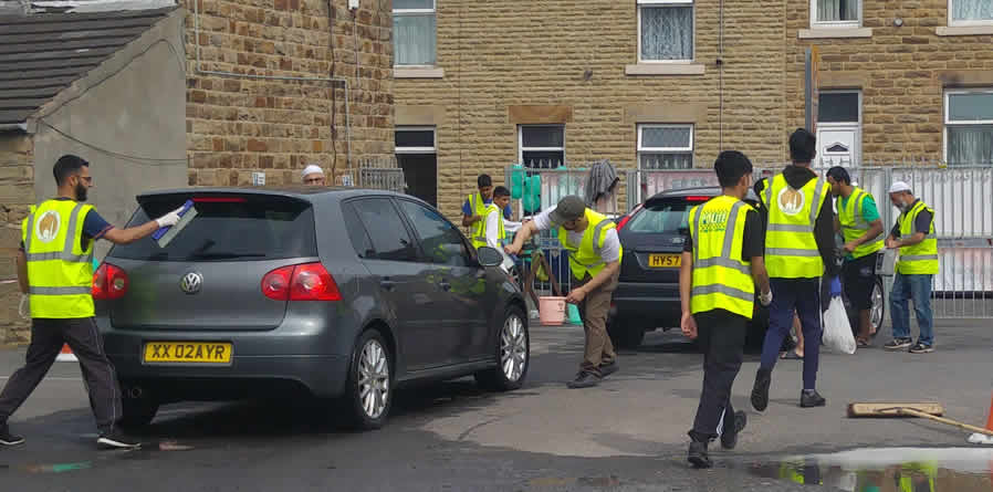 Raising Money for cancer research UK with community car wash