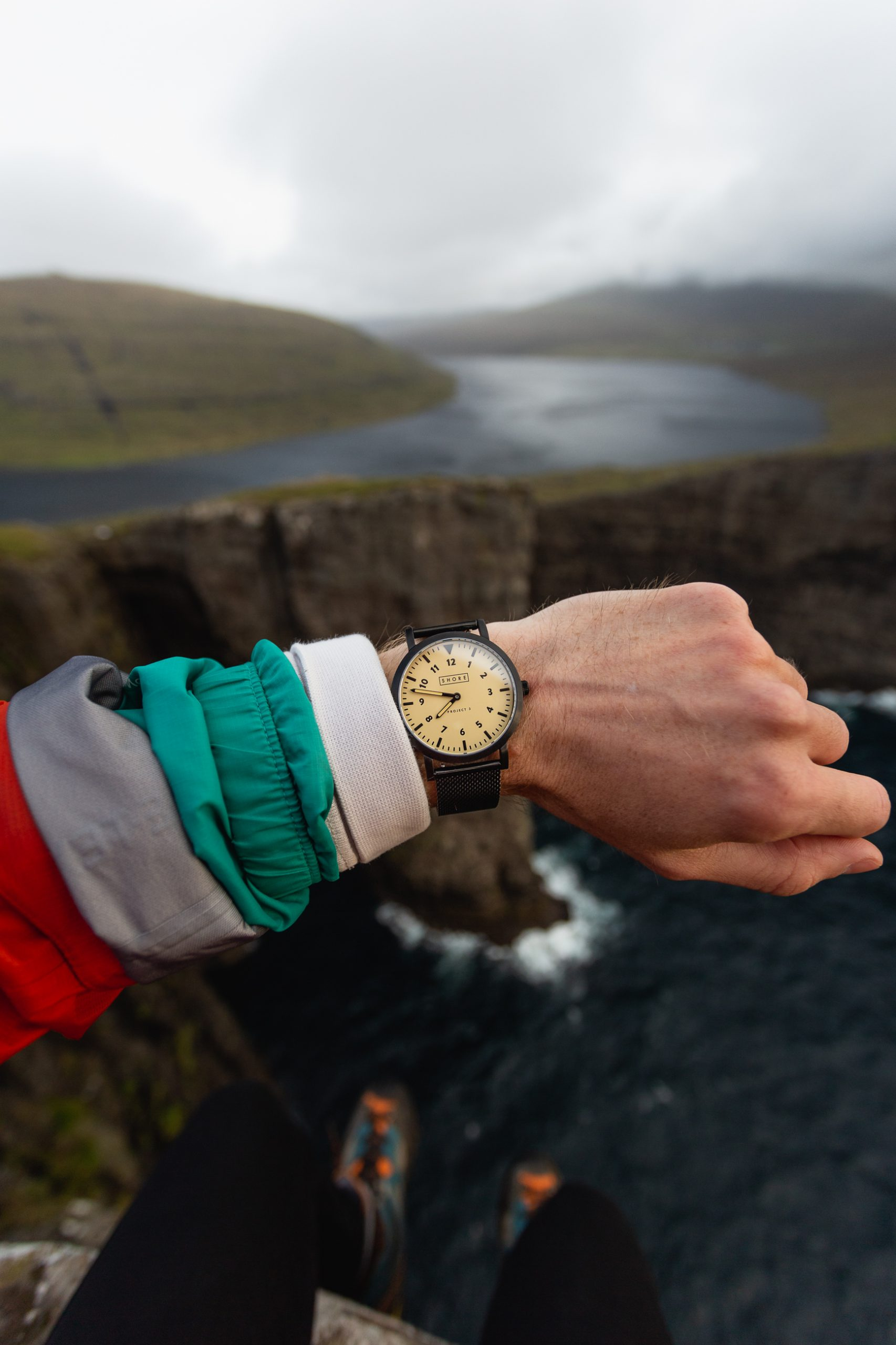 wearing a watch with incredible coastal backdrop