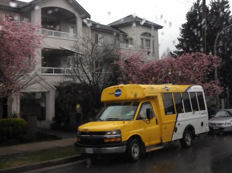 A HandyDart bus is stopped outside a residential complex in South Burnaby. Photo by myself