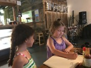 Drawing with one of the restaurant owners' daughters