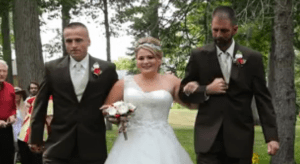 Brittany walks down the aisle with her dad and stepdad.