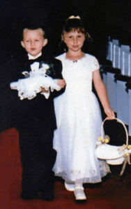 Adrian and Brooke walk down the aisle in a North Carolina church as flower girl and ring bearer.