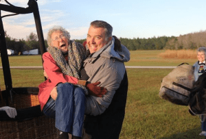 Norma, climbing aboard for a hot air balloon ride, a lifelong dream come true. Credit: Driving MIss Norma/FB