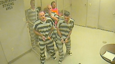 Inmates locked up in a Texas jail bust out of their cell in order to save the life of an armed guard who appeared to suffer a heart attack.