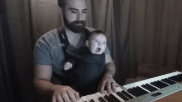 """David Motola, also known as, """"Bearded Piano,"""" gets his baby Sam to sleep by playing Brahms' lullaby."""