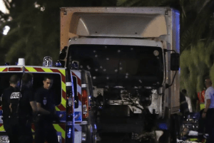 Police stand near a truck riddled with bullet holes after the attack on Bastille Day 2014 in Nice, France.