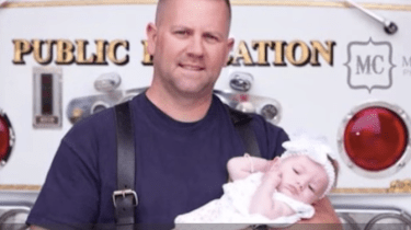Firefighter Marc Hadden adopts the baby girl he helped to deliver in the back of an ambulance.