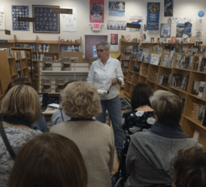 """Author Bren McClain keeps fans transfixed as she reads from her novel, """"One Good Mama Bone."""""""