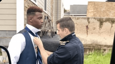 Pennsylvania Ambulance paramedic Jared Bryer helps teen tie his tie before prom.