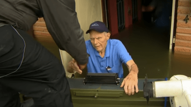 CNN correspondent Ed Lavandera and his crew help rescue an elderly couple caught in the floods in Dickinson, Texas.