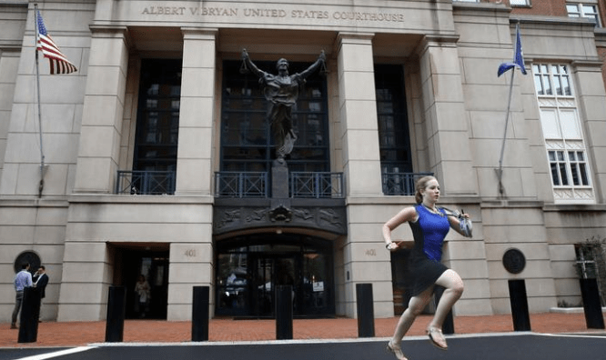 NBC News intern Cassie Semyon sprints out of the courthouse Aug. 21, 2018, in Alexandria, Va., after Paul Manafort was found guilty on eight counts of tax evasion and bank fraud. (Jacquelyn Martin / AP)
