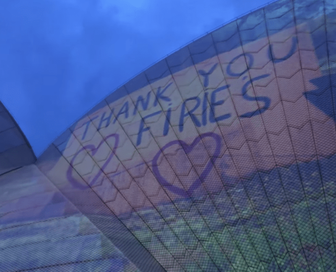 """Thank you, Firies"" showing gratitude to the firefighters on the side of the Sydney Opera House."