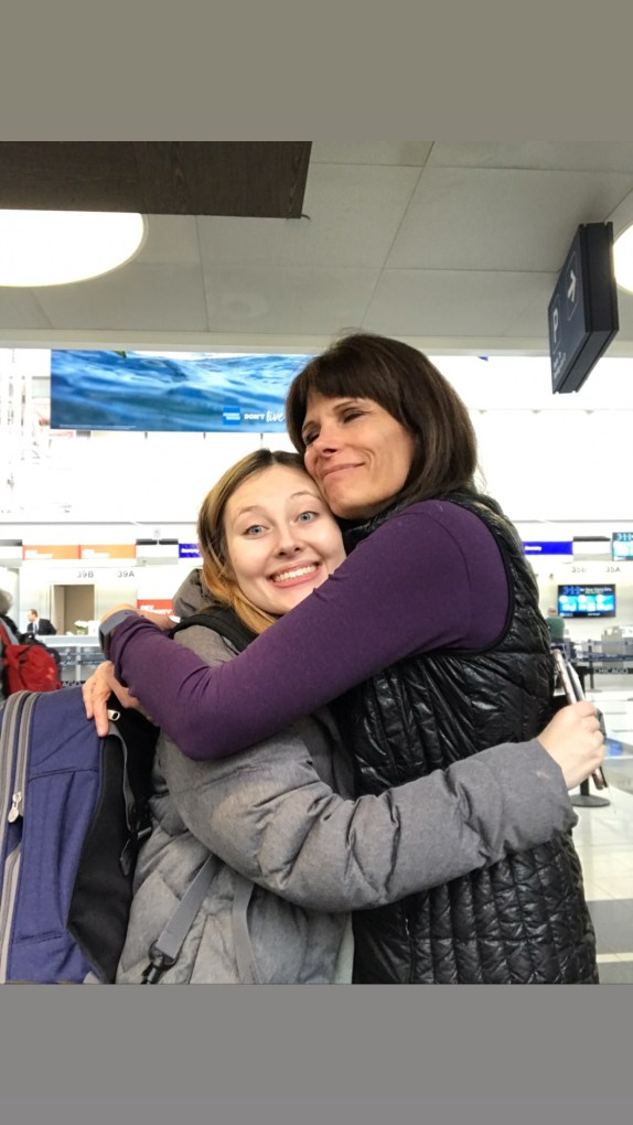 Flying 2,000 miles and surprising our daughter was worth it for this hug alone.