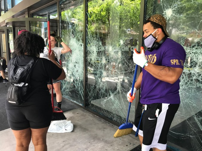 Strangers with no connection to the company show up to help clean up CNN Center Atlanta after a night of riots.