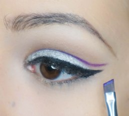 Create a cut crease with purple matte eyeshadow and a very dense angled brush. You have to be very precise drawing your cut-crease, draw it right there as it is and you'll be just fine :) I used UD pressed pigment with wet brush so it converted into the eyeliner; UD Urban with Sigma E11