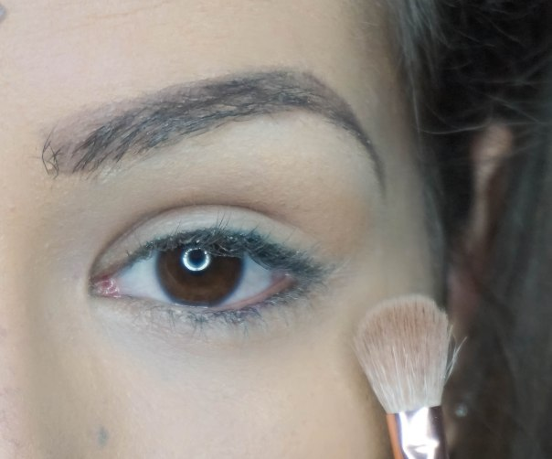 apply base eyeshadow under your brow bone and blend; PRE-GAME with S E60