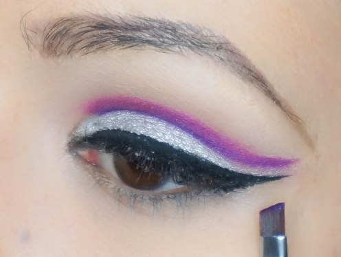Then come back with angled brush and matte purple and draw a cut crease line again so it will really stand out; UD Urban with SE11