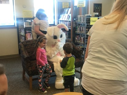 Young children talking to Easter bunny