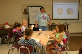 Teacher working with kids