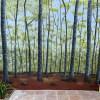 Mural de bosque pintado a mano en pared con graffiti