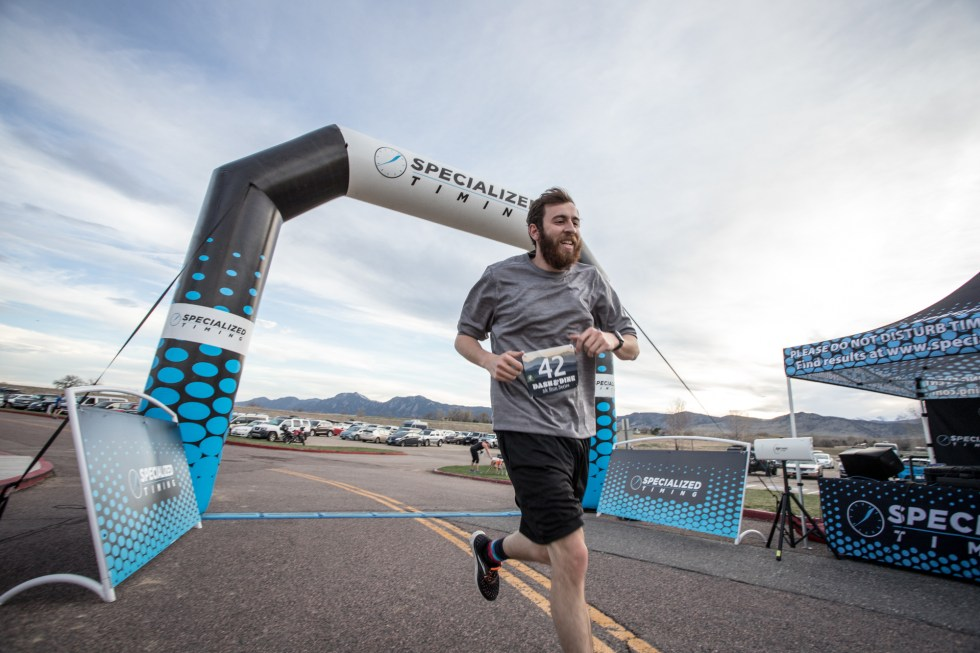 Runners finish the first Dash & Dine 5k at the Boulder Reservoir