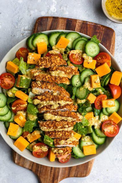 Pretzel crusted chicken salad with mustard dressing