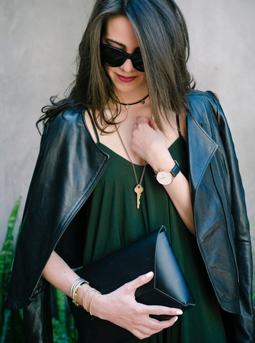 Jackie Roque styling a Urban Outfitters jumpsuit, Trouve leather jacket, a Giving Key, and Joie Shoes