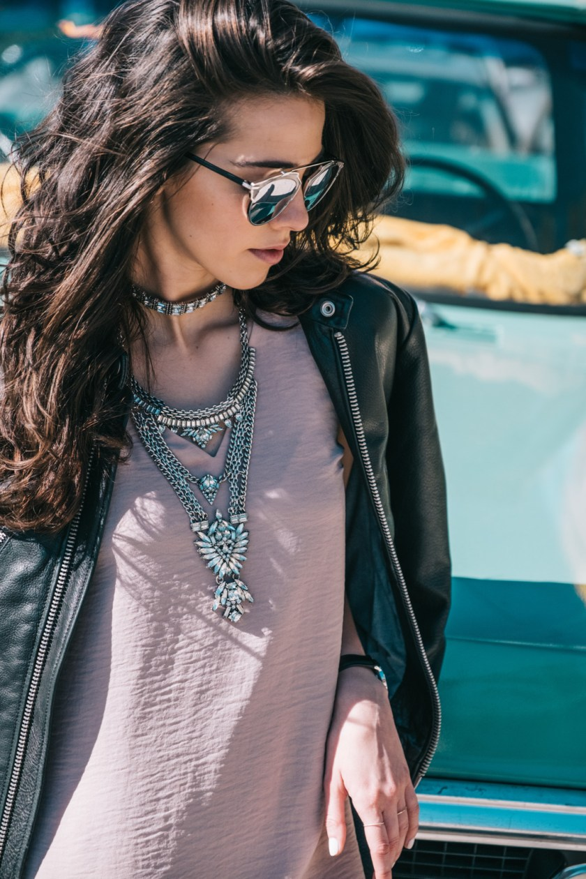 Jackie Roque styling a Bauble Bar statement necklace and Dior sunglasses