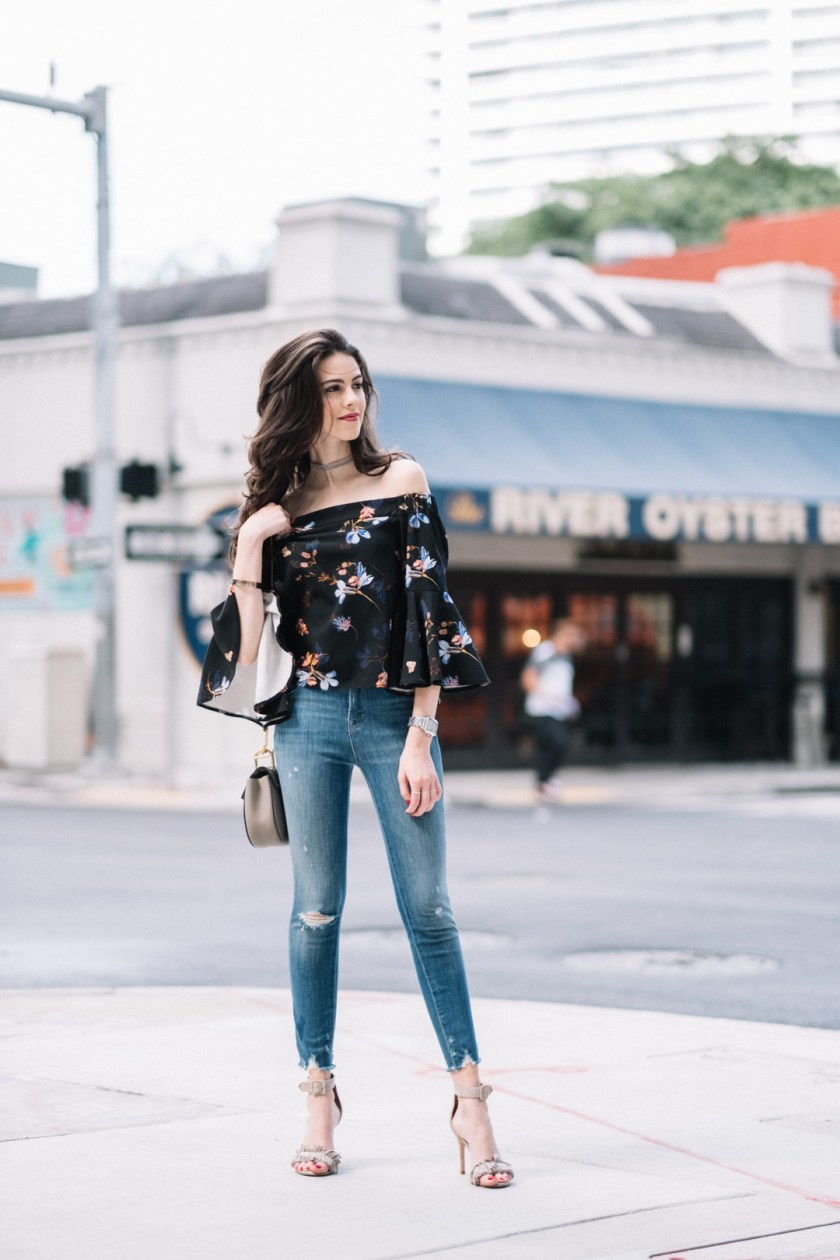 Jackie Roque styling a Toyshop off-the-shoulder floral top, with J Brand Alana ripped jeans, Chloe Drew bag and Joie Pippi shoes.