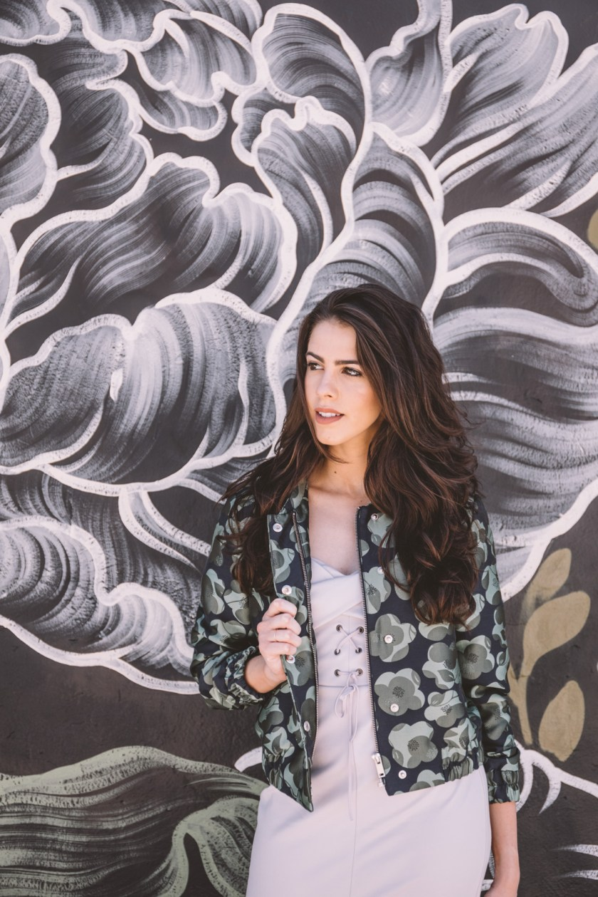 Jackie Roque styling a Topshop dress and Banana Republic jacket in Wynwood Miami.